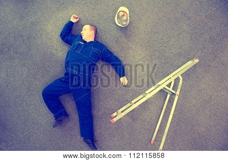 Worker Lying On The Ground