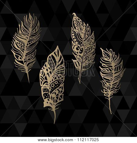 Hand drawn vector zentangle gold feathers set on black triangle geometric background.
