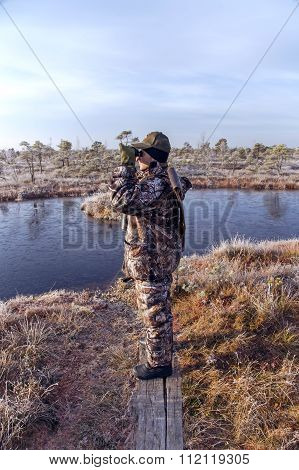 Hunter in the early morning on Kemeri swamp