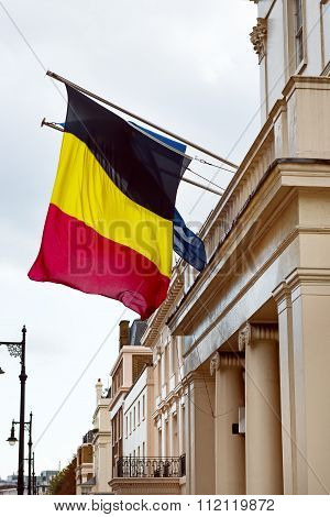 Belgium and European Union flags waving from the embassy balcony in London exterior view front entra