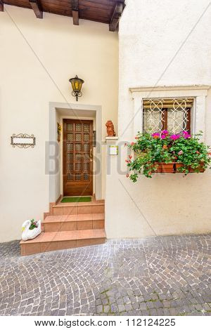 Picturesque small town street view in Limone, Lake Garda Italy. Entrance of an apartment or house.