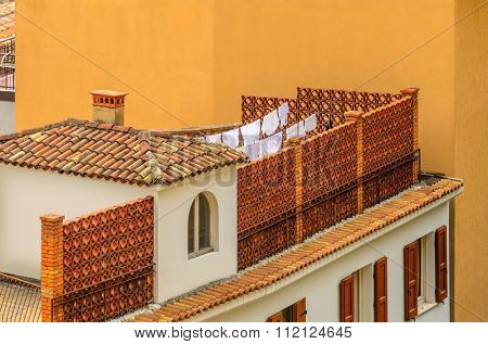 Nice mediterranean house roofs with different colours in Limone, Garda, Italy.