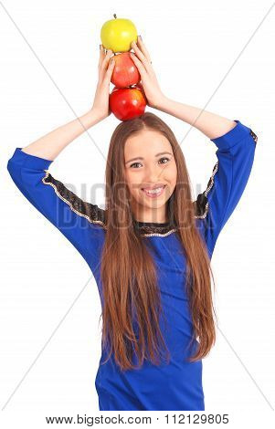 Young Girl Holds An Three Apples On Her Head