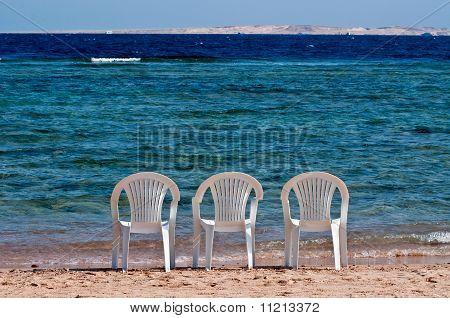 Three Chairs On The Beach