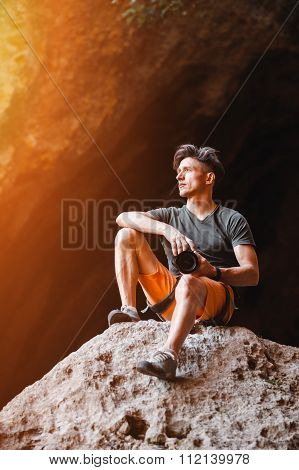 Male photographer on the cliff looking on horizon