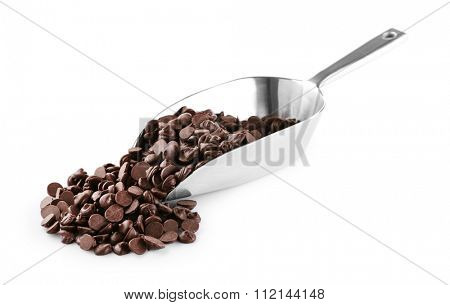 Chocolate morsels in scoop isolated on white
