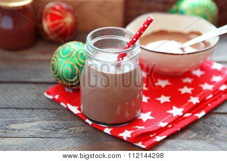 Chocolate dessert and chocolate milk cocktail on wooden background