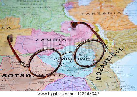 Glasses on a map - Harare