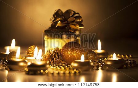 Gift box, candles and christmas ornaments