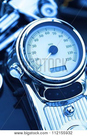 Close up motorcycle speedometer board with blue toned