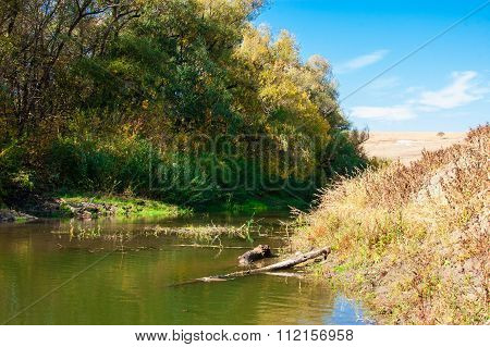 River Landscape With White Clouds.