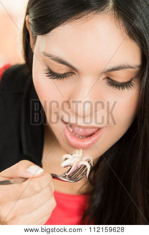 Beautiful girl eating fresh delicious calamari