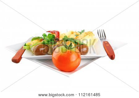 baked cannelloni with cheese served with greenery on dish