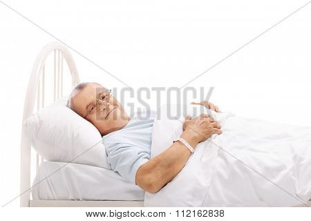 Senior patient lying on a hospital bed and looking at the camera isolated on white background