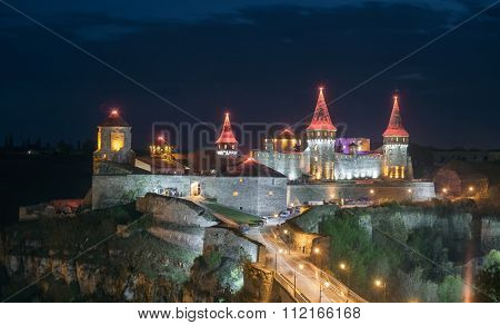 View on the castle in Kamianets Podilskyi in the night. Ukraine