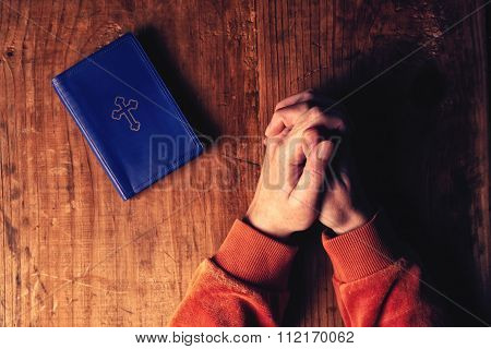 Christian Woman Praying With Hands Crossed