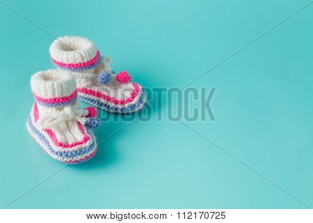 Baby Birthday Invitation. Knitted Booties Closeup View