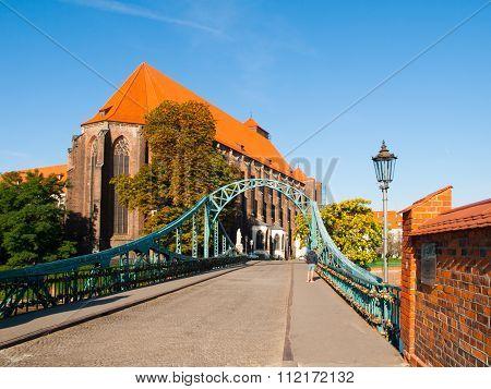 Tumski Bridge and St. Mary's Church in Wroclaw