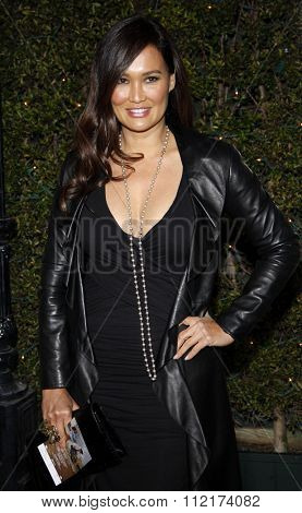 HOLLYWOOD, CALIFORNIA - January 11, 2010. Tia Carrere at the Los Angeles premiere of