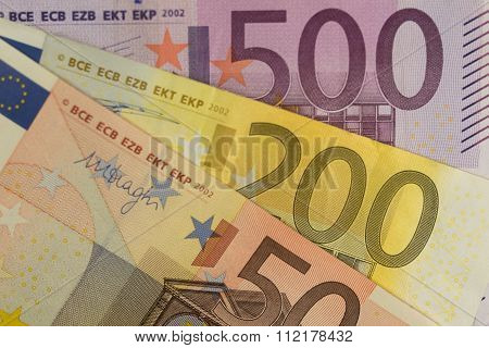 Euro bank notes fanned out close-up