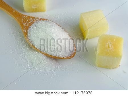Sugar On  Spoon With Sugarcane Cube