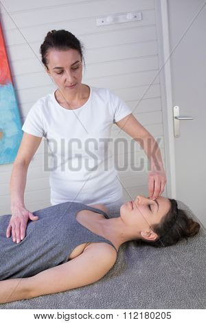 Reiki Therapy With A Young Woman Working As Spirit Healer