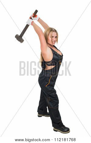 Busty sexy girl with a hammer in his hand.