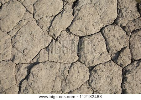 Rock surface with cracks an uneven background texture illustration