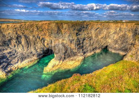 Beautiful Wine Cove Cornwall coast turquoise blue sea with snorkellers in HDR near Treyarnon