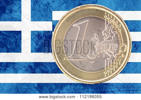 One Euro Coin On The Flag Of Greece As Background