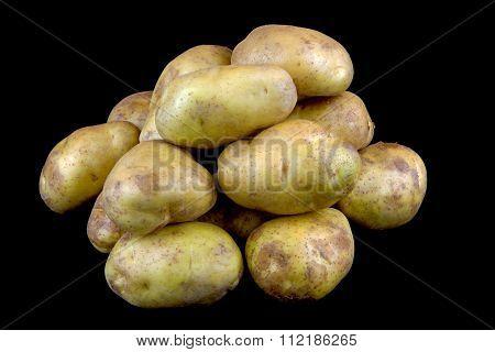 Organic Potatoes On Black Background