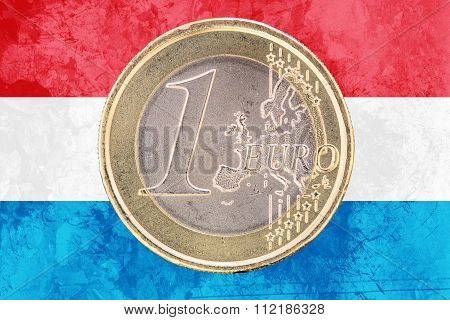 One Euro Coin On The Flag Of Luxembourg As Background