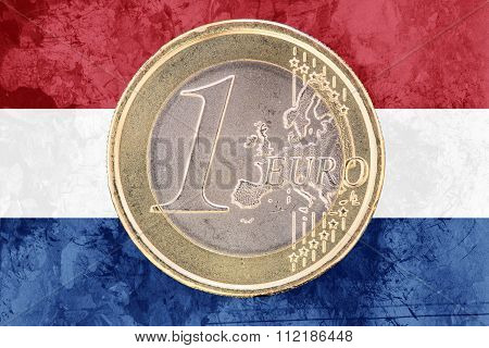 One Euro Coin On The Flag Of Netherlands As Background