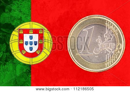One Euro Coin On The Flag Of Portugal As Background