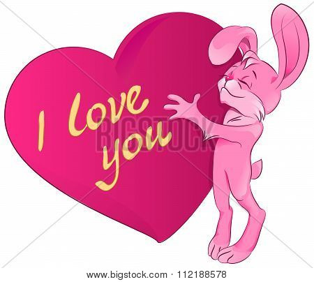 Pink rabbit embraces the heart. I love you