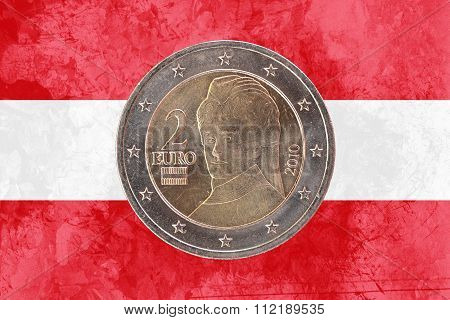 Austrian Two Euros Coin With Flag Of Austria As Background