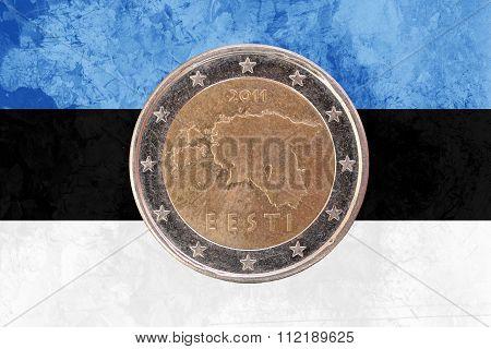 Estonian Two Euros Coin With Flag Of Estonia As Background