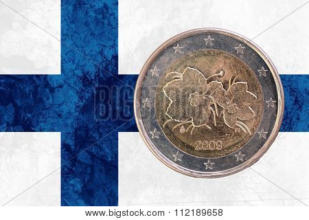 Finnish Two Euros Coin With Flag Of Finland As Background