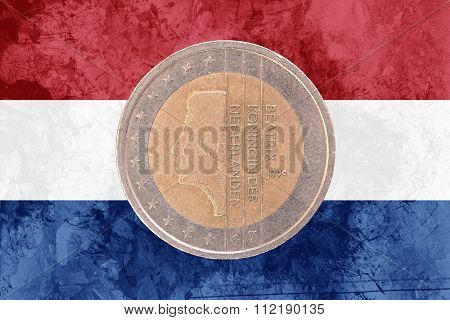 Dutch Two Euros Coin With Flag Of Netherlands As Background