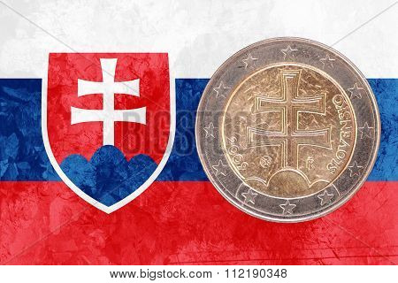Slovak Two Euros Coin With Flag Of Slovakia As Background