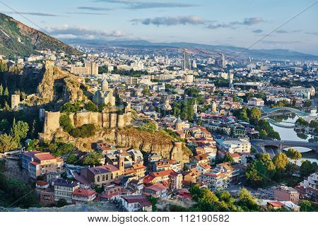 Touristic landmark in Tbilisi Georgia. Panorama of fortress citadel Narikala with St Nikolas church
