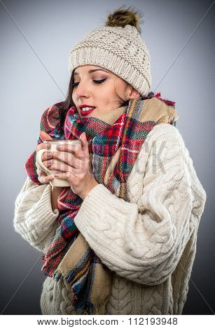Attractive Woman Enjoying A Hot Cup Of Coffee