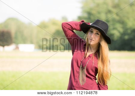 Beautiful Bohemian Girl With A Bordeaux Shirt
