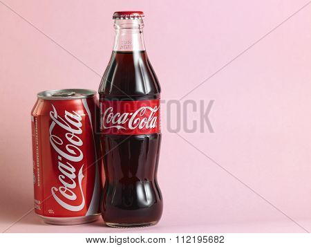 kuala lumpur,malaysia, december 13rd 2015, coca cola glass bottle and can on the pink background