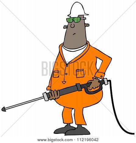 Worker using a pressure wand