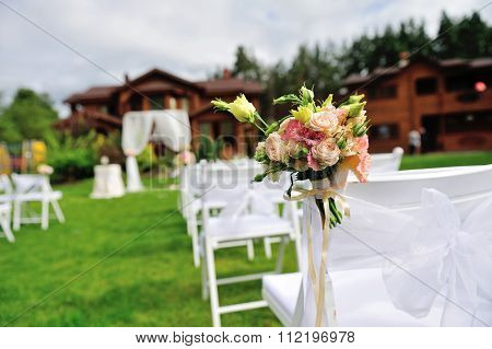 Green lawn for wedding ceremony.