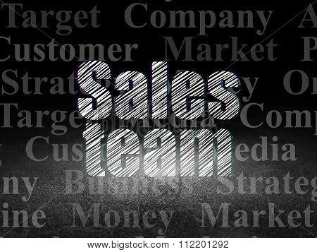 Marketing concept: Sales Team in grunge dark room