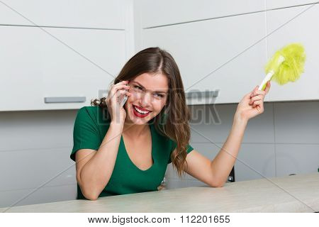 Woman Dusting And Cleaning Her House
