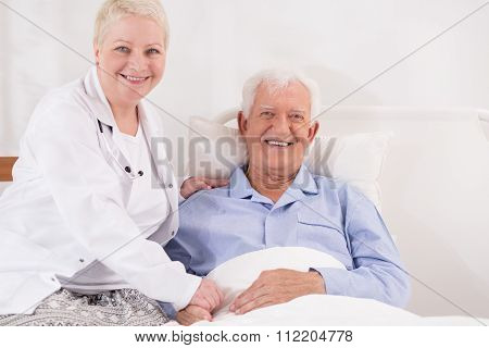 Elderly Patient Recovering In Bed