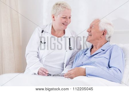 Nurse Smiling To Her Senior Patient